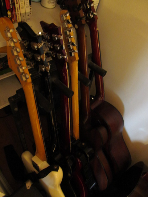Over Crowded Guitar Rack